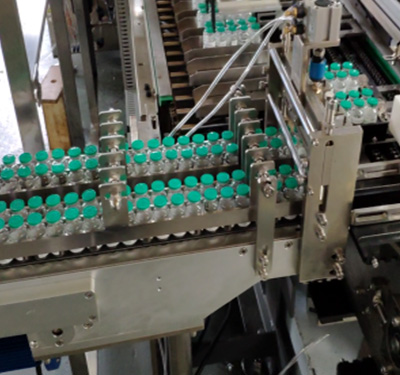 Vial bottle to tray and cartoning machine