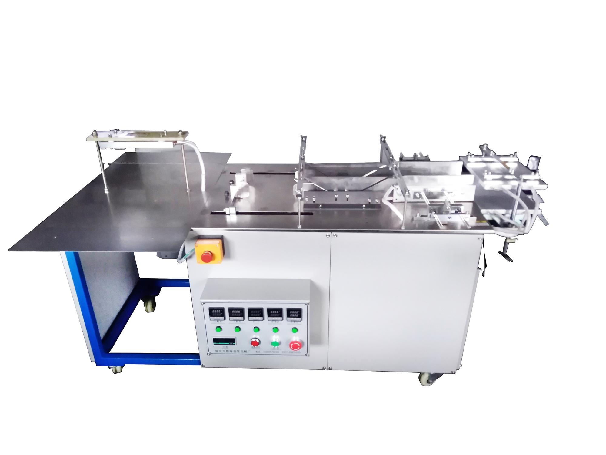 YH-620型半自动透明膜三维包装机