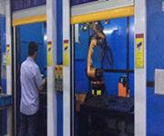 The robot welding the protective door